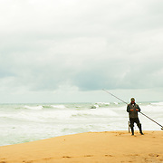 Fisherman at beach of Ericeira
