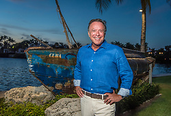 Mike Fernandez, founder of MBF Healthcare Partners, at his home in Coral Gables, next to the wreckage of a boat used by refugees to cross the Florida Straights from Cuba to the US. Fernandez came to America from Cuba in 1964 at age 12. Fernandez's personal net worth has crossed the $1 billion-plus mark.