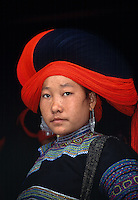 I made this photograph of a hilltribe (a.k.a. montagnard in Vietnam) girl at the outdoor market in Bac Ha Vietnam. Although only 110 kilometers (68 miles) from Sapa, the trip took over five hours in the old Russian built 4X4 I rented. Getting there was truly half the fun! The remoteness of Bac Ha also makes it a photographer's paradise. Upon arrival at the market, I found no tourists and had the bustling collage of the ten different hilltribes that live, farm and raise livestock in the surrounding hills to myself. As much as it is obviously a place to buy, sell and trade their goods, the market also serves as an important social gathering place to all of the tribes in the region..This young girl, as with all of the women at the market, uses this large social gathering to showcase her most elaborate handmade headdress and silver jewelry. Individuals take great pride in their attire because it reflects not only the tribe the belong to, but also their families social status and wealth. Just as I had framed her gnawing on her favorite market treat, a stalk of sugarcane, she took a break and glanced perfectly into my lens providing me with this image and the knowledge that having a sweet tooth is truly cross-cultural.