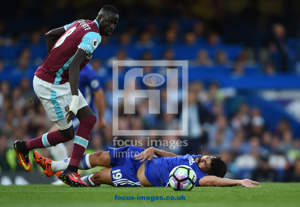 Chelsea's Diego Costa of Chelsea and Cheikhou Kouyate of West Ham United during the Premier League match at Stamford Bridge, London<br /> Picture by Daniel Hambury/Focus Images Ltd +44 7813 022858<br /> 15/08/2016