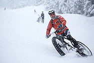 Gregoire Erbeia of Switzerland looses the front wheel during stage 5 of the first Snow Epic, the Trübsee climb near Engelberg, in the heart of the Swiss Alps, Switzerland on the 17th January 2015<br /> <br /> Photo by:  Nick Muzik / Snow Epic / SPORTZPICS