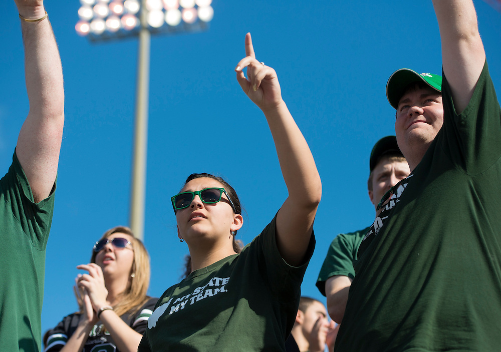 Tiffany Frans cheers for the Ohio University Bobcats at the homecoming game which took place on Saturday, October 12, 2013. The Bobcats lost against the Central Michigan Chippewas 26 to 23.