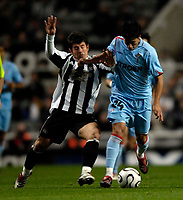 Photo: Jed Wee.<br /> Newcastle United v Celta Vigo. UEFA Cup. 23/11/2006.<br /> <br /> Newcastle's Emre (L) tries to tackle Celta Vigo's Canobbio.