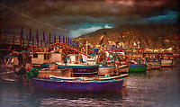 """""""Sorrento panorama of tired fishing boats - Marina Grande Sorrento – Vintage""""…<br /> <br /> Duomo di Sorrento is one of my favorite hidden treasures of Italy. Our last day on the bellissimo Amalfi Coast, Father Peak offered a venerable morning Mass for our semi-exhausted group of Pilgrims upon the High Altar. Hallelujah, it was our first free day of the 2019 Pilgrimage and most were heading to Capri. I convinced my fellow Pilgrim Patrick that Marina Grande was the preferred location to commemorate this rain-threatened day. Sunday afternoon in this tiny hallowed port on the Mediterranean was bustling, not with tourists, but with energetic and unassuming locals. The misty skies were vulnerable all day with the promise of rain, but the reluctant sun penetrated the clouds for a few fortuitous moments. God painted the skies for brief moments with luminous pastel elements of abstract color. We left after lunch only to humbly return perceiving the brilliant orange skies cascading down upon the piccolo village as a gift from Heaven. Glorious rumination abounds with the thought of sacred scripture; """"John answered them all, saying, 'I am baptizing you with water, but one mightier than I is coming. I am not worthy to loosen the thongs of his sandals. He will baptize you with the Holy Spirit and fire. His winnowing fan is in his hand to clear his threshing floor and to gather the wheat into his barn, but the chaff he will burn with unquenchable fire."""" (Luke 3:16-17) I am not an expert in, nor born in Marina Grande or Sorrento, but the Gulf of Naples is where my Grandfather and his family are from. It seems that every time I have set foot in this tiny village, the skies explode with color and welcome its former lineage home. Shortly after the last picture was captured, it was meal time with the entire Pilgrimage group. A perfect dinner at my favorite restaurant, Ristorante di """"Zi'Ntonio Mare, was enjoyed by all!"""