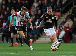 Harry Pell of Cheltenham Town applies pressure on George Cooper of Crewe Alexandra   - Mandatory by-line: Nizaam Jones/JMP - 05/11/2016 - FOOTBALL - LCI Rail Stadium - Cheltenham, England - Cheltenham Town v Crewe Alexandra - Emirates FA Cup first round