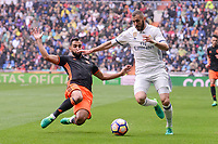 Real Madrid's Karim Benzema and Valencia CF's Martin Montoya during La Liga match between Real Madrid and Valencia CF at Santiago Bernabeu Stadium in Madrid, April 29, 2017. Spain.<br /> (ALTERPHOTOS/BorjaB.Hojas)