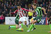 Paul Robinson of AFC Wimbledon stops Jamie Reid of Exeter City in his tracks during the Sky Bet League 2 match between Exeter City and AFC Wimbledon at St James' Park, Exeter, England on 28 December 2015. Photo by Stuart Butcher.