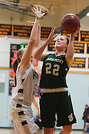 St. Johnsbury's Emilie Begin (22) leaps past Essex's Kylie Archer (50) for a lay up during the girls basketball game between the St. Johnsbury Hilltoppers and the Essex Hornets at Essex high school on Tuesday night January 5, 2016 in Essex. (BRIAN JENKINS/for the FREE PRESS)