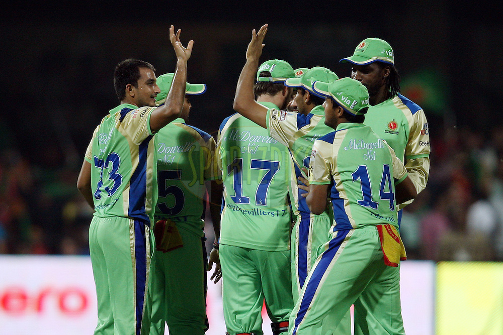 RCB players celebrate a wicket during match 62 of the the Indian Premier League ( IPL) 2012  between The Royal Challengers Bangalore and the Mumbai Indians held at the M. Chinnaswamy Stadium, Bengaluru on the 14th May 2012..Photo by Jacques Rossouw/IPL/SPORTZPICS