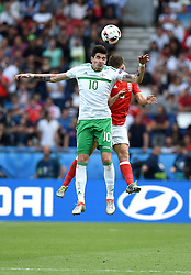 Kyle Lafferty of Northern Ireland battles for the high ball with,  Ben Davies of Wales  - Mandatory by-line: Joe Meredith/JMP - 25/06/2016 - FOOTBALL - Parc des Princes - Paris, France - Wales v Northern Ireland - UEFA European Championship Round of 16