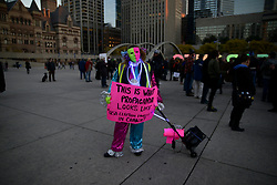 November 13, 2016 - Toronto, Canada - Linda an activist who doesn't approve a protest on an issue relating to USA and not Canada-wearing her mask during a rally in Toronto, Canada on 13 November 2016. (Credit Image: © Arindam Shivaani/NurPhoto via ZUMA Press)
