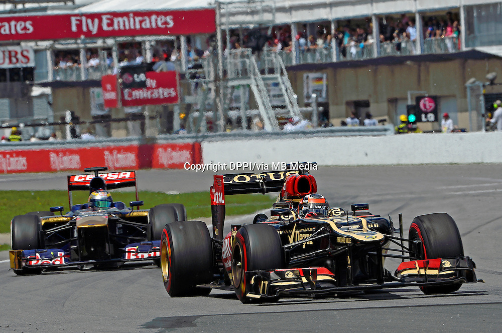 MOTORSPORT - F1 2013 - GRAND PRIX OF CANADA - MONTREAL (CAN) - 07 TO 09/06/2013 - PHOTO ERIC VARGIOLU / DPPI RAIKKONEN KIMI (FIN) - LOTUS E21 RENAULT - ACTION<br /> VERGNE JEAN-ERIC (FRA) - TORO ROSSO STR8 FERRARI - ACTION