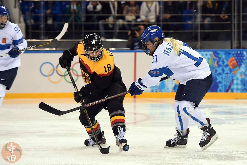 Feb 16, 2014; Sochi, RUSSIA; Germany defenseman Susanne Fellner (18) battles for the puck with Finland forward Annina Rajahuhta (11) in the women's ice hockey classifications round during the Sochi 2014 Olympic Winter Games at Shayba Arena.
