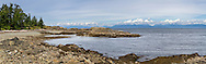 Panorama of the rocky shore and the Straight of Georgia from Rathtrevor Beach Provincial Park in Parksville, British Columbia, Canada
