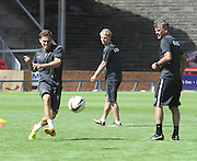 Gary MacKay-Stevens and coach Darren Jackson watch David Goodwillie practice his shooting - Dundee United open day at Tannadice<br /> <br />  - Pictures © David Young