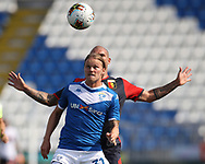 Brescia Calcio's Icelandic midfielder Birkir Bjarnason holds off the attentions of Genoa's Italian midfielder Stefano Sturaro during the Serie A match at Stadio Mario Rigamonti, Brescia. Picture date: 27th June 2020. Picture credit should read: Jonathan Moscrop/Sportimage