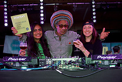 DJ, filmmaker and radio broadcaster Don Letts gets this weekend's craft beer festival at the Biscuit Factory, Edinburgh, in the mood accompanied by Pooja Padel (left), a brewing studies student at Heriot Watt University, and Chloe West of Stone and Wood Brewery. Pic copyright Terry Murden @edinburghelitemedia