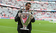 A UEFA employee with the UEFA Champions League trophy ahead of the semi final second leg between Bayern Munich and Atletico Madrid at Allianz Arena, Munich<br /> Picture by EXPA Pictures/Focus Images Ltd 07814482222<br /> 03/05/2016<br /> ***UK &amp; IRELAND ONLY***<br /> EXPA-FEI-160503-5000.jpg
