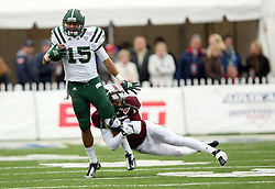 Ohio's Derrius Vick pulls in a reception past Louisiana-Monroe's Cordero Smith during the first quarter of the Independence Bowl NCAA college football game, Friday, Dec. 28, 2012, in Shreveport, La.