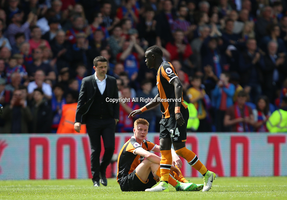 May 14th 2017, Selhurst Park, London, England; EPL Premier League football, Crystal Palace versus Hull Tigers; Oumar Niasse of Hull City consoles Sam Clucas of Hull City with a tap on the head