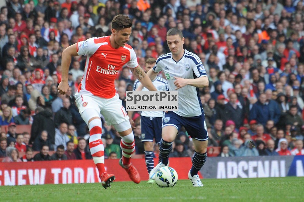 Arsenals Oliver Giroud and West Broms Craig Gardner in action during the Arsenal v West Brom match on Sunday 24th May 2015