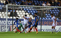 Osman Sow of Milton Keynes Dons has a shot at goal but it is kept out by Michael Doughty and Jonathan Bond of Peterborough United - Mandatory by-line: Chantelle McDonald/JMP - 12/09/2017 - FOOTBALL - ABAX Stadium - Peterborough, England - Peterborough United v Milton Keynes Dons - Sky Bet League One