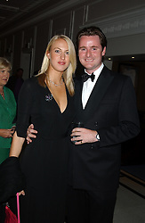 MR HARRY & LADY PORTIA BAKER at the annual Ascot charity auction dinner this year in aid of The Princes Trust held at the Hyatt Churchill Hotel, Portman Square, London on 21st September 2004.<br />