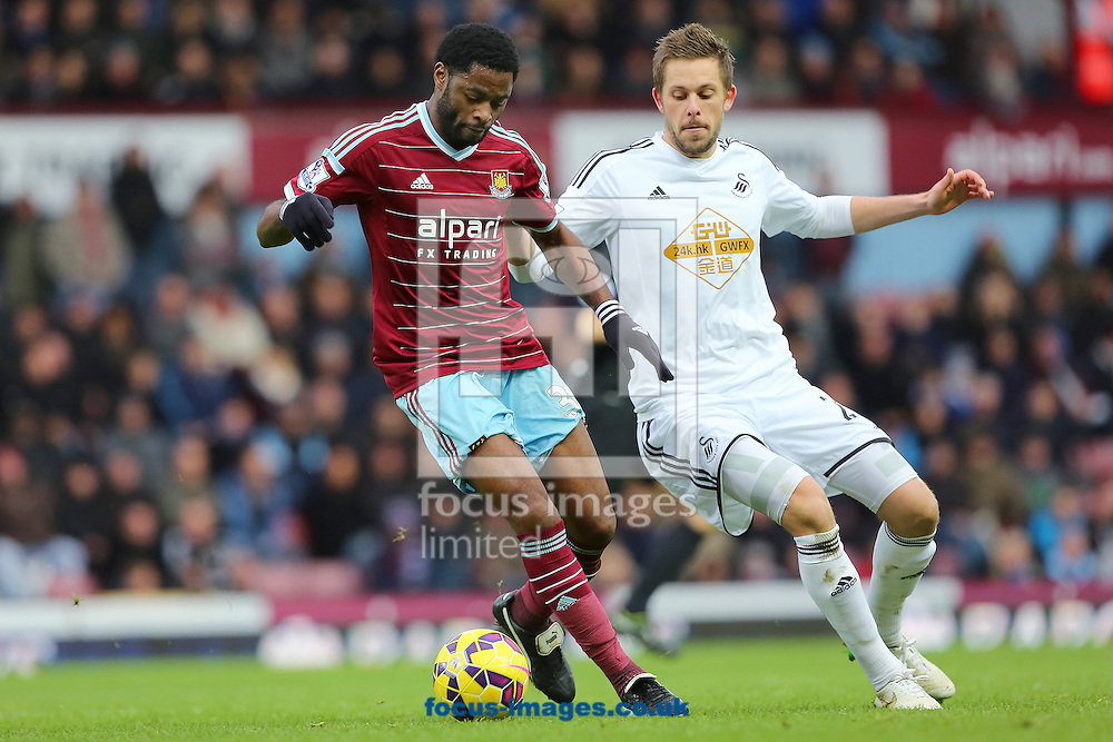 Alexandre Song of West Ham United and Gylfi Sigurosson of Swansea City during the Barclays Premier League match at the Boleyn Ground, London<br /> Picture by Richard Calver/Focus Images Ltd +447792 981244<br /> 07/12/2014