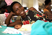 Harriet Massamula and her newly born baby on the ward at Kitovu Hospital.<br />