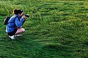Amateur photographer shooting nature travel photos.