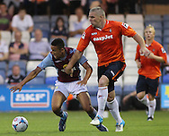 Picture by David Horn/Focus Images Ltd +44 7545 970036<br /> 23/07/2013<br /> Steve McNulty of Luton Town holds off Callum Robinson of Aston Villa during the Pre Season Friendly match at Kenilworth Road, Luton.