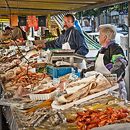 This is the outdoor market scene that happens twice each week in Croissy-sur-Seine, France.  Vendors set up shop on one of the main sidewalks and everyone buys ingredients for a fresh dinner.  Aspect Ratio 1w x 1h