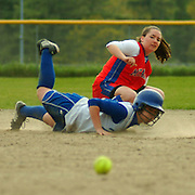 BATH  Maine -- May 23, 2007 -- Morse Catcher Alejandra Rodriguez dives back to second on a tagup as the ball bounces by Mt. Ararat's Samantha Owen In a 10 inning game at Legion Field. Morse beat Mt. Ararat 3-2 at the very end.  Photo by Roger S. Duncan