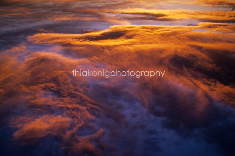 Sunset over layered clouds, seen from above.