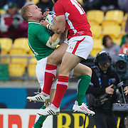 Keith Earls, Ireland and Leigh Halfpenny, Wales, challenge for the ball  during the Ireland V Wales Quarter Final match at the IRB Rugby World Cup tournament. Wellington Regional Stadium, Wellington, New Zealand, 8th October 2011. Photo Tim Clayton...
