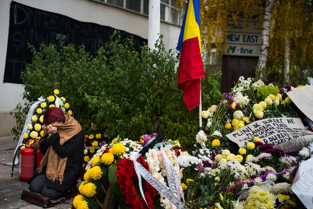 A woman weeps  outside of Colectiv, a rock club that was the site of a deadly fire, on November 8, 2015 in Bucharest, Romania.