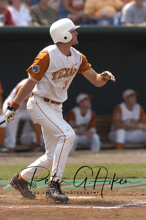 Texas first basemen Chance Wheeless hits a solo homerun in the bottom of the sixth inning.  Texas defeated Florida 6-2 for the National Championship at the College World Series at Rosenblatt Stadium in Omaha, Nebraska on June 26, 2005.