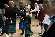 A couple dancing at a St. Andrew's dinner dance held by the Sandbach and District Caledonian Society at Sandbach Town Hall, Cheshire, England on St. Andrew's Day. Around 40 people from the Society attended the meal and dance which included a programme of Scottish country dancing. St. Andrew was the patron saint of Scotland and the day was celebrated by Scots worldwide on the 30th November.