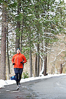 Brian Pomerantz works through the halfway point of his 10-mile run Thursday as he jogs around North Idaho College on Rosenberry Drive.