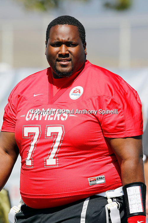 Actor Quinton Aaron (77) who played Baltimore Ravens offensive tackle Michael Oher in the 2009 movie The Blind Side plays flag football in the EA Sports Madden NFL 11 Launch celebrity and NFL player flag football game held at Malibu Bluffs State Park on July 22, 2010 in Malibu, California. (©Paul Anthony Spinelli)