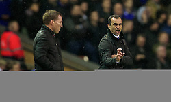 28.01.2014, Anfield, Liverpool, ENG, Premier League, FC Liverpool vs FC Everton, 23. Runde, im Bild Liverpool's manager Brendan Rodgers and Everton's manager Roberto Martinez // during the English Premier League 23th round match between Liverpool FC and Everton FC at Anfield in Liverpool, Great Britain on 2014/01/29. EXPA Pictures &copy; 2014, PhotoCredit: EXPA/ Propagandaphoto/ David Rawcliffe<br /> <br /> *****ATTENTION - OUT of ENG, GBR*****