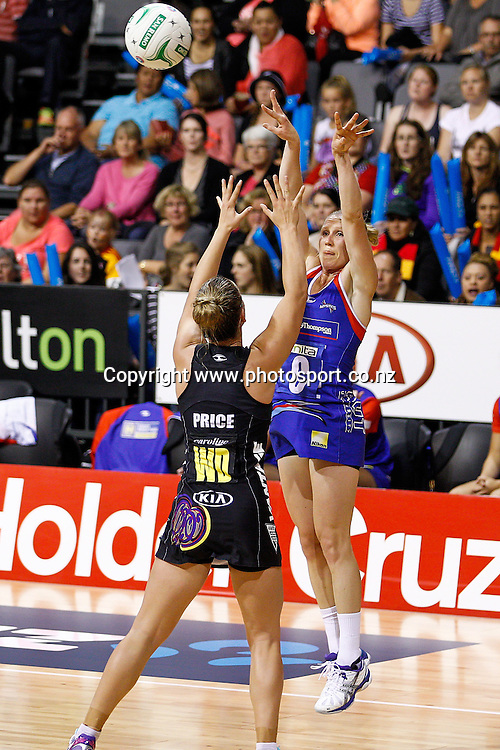 Northern Mystic's Laura Langman passes over Waikato BOP Magic's Jamie-Lee Price during the ANZ Championship netball match - Waikato BOP Magic v Northern Mystics at Claudelands Arena, Hamilton, New Zealand on Saturday 20 April 2014.  Photo:  Bruce Lim / www.photosport.co.nz