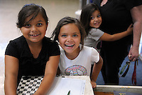 From left, Elvira, 7, Jessica, 6, and Stormy Ferrel, 4, sign in at the El Dorado Park Recreation Center for a four-hour City of Salinas Parks and Community Services program in which they can use the play facilities under gentle supervision.
