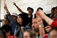 Nora Cantu, mother of senior player Seth Cantu, puts her hands up and hopes for two free throw points Tuesday, Feb. 14, 2012 during Premont's final basketball game of the season.