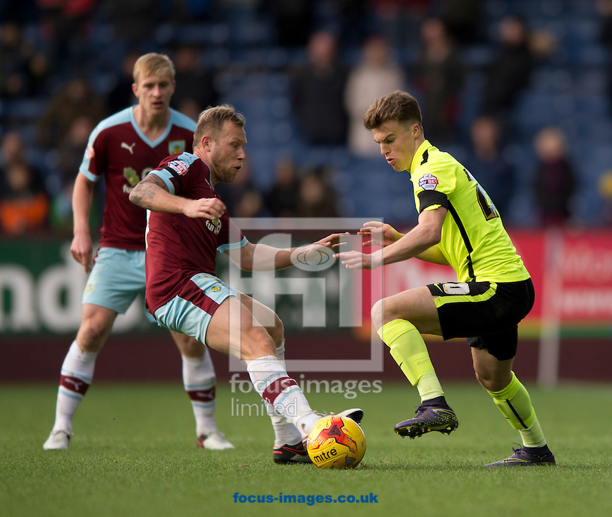 Solly March of Brighton and Hove Albion (right) turns inside Scott Arfield of Burnley (centre) during the Sky Bet Championship match at Turf Moor, Burnley<br /> Picture by Russell Hart/Focus Images Ltd 07791 688 420<br /> 22/11/2015