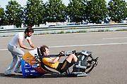 Rik Houwers legt de eerste meters in de VeloX V fietsend af. Op de RDW baan in Lelystad wordt getest met de VeloX 4, de fiets van vorig jaar, en voor het eerst ook met de nieuwste fiets, de VeloX V. In september wil het Human Power Team Delft en Amsterdam, dat bestaat uit studenten van de TU Delft en de VU Amsterdam, een poging doen het wereldrecord snelfietsen te verbreken, dat nu op 133,8 km/h staat tijdens de World Human Powered Speed Challenge.<br /> <br /> At the RDW track in Lelystad the team tests wit the VeloX 4 and for the first time with the VeloX V. With the special recumbent bike the Human Power Team Delft and Amsterdam, consisting of students of the TU Delft and the VU Amsterdam, also wants to set a new world record cycling in September at the World Human Powered Speed Challenge. The current speed record is 133,8 km/h.