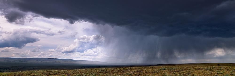 Storm clouds come off Juniper Mountain and race across the Owyhee desert floor.