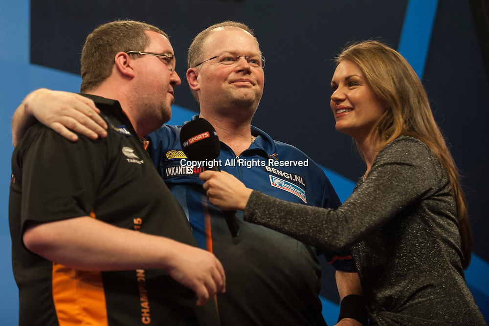 02.01.2014.  London, England.  William Hill PDC World Darts Championship.  Quarter Final Round.  Raymond van Barneveld (14) [NED] and Stephen Bunting (27) [ENG] are interviewed by Sky Sports Reporter Laure James.  Raymond van Barneveld won the match 5-4