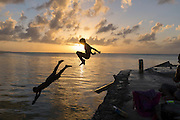 Kids diving off Sugar Dock in Saipan's lagoon. It's like the public swimming pool.