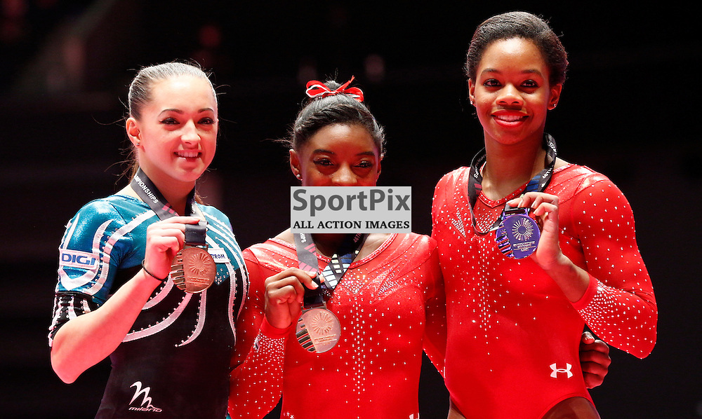2015 Artistic Gymnastics World Championships being held in Glasgow from 23rd October to 1st November 2015.....L-R Larisa Andreea Iordache (Romania) Bronze medal, Simone Biles (USA) Gold medal and Gabrielle Douglas (USA) Bronze medal  in the Women's All-Round Final...(c) STEPHEN LAWSON | SportPix.org.uk